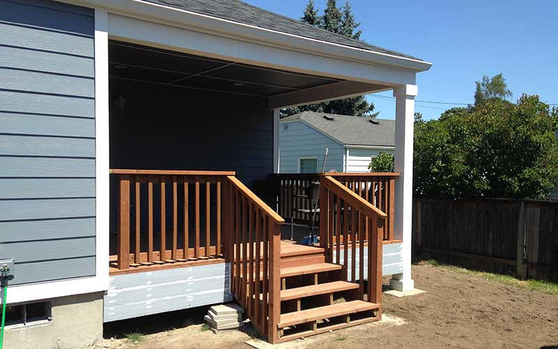 Residential addition of covered back porch and living space