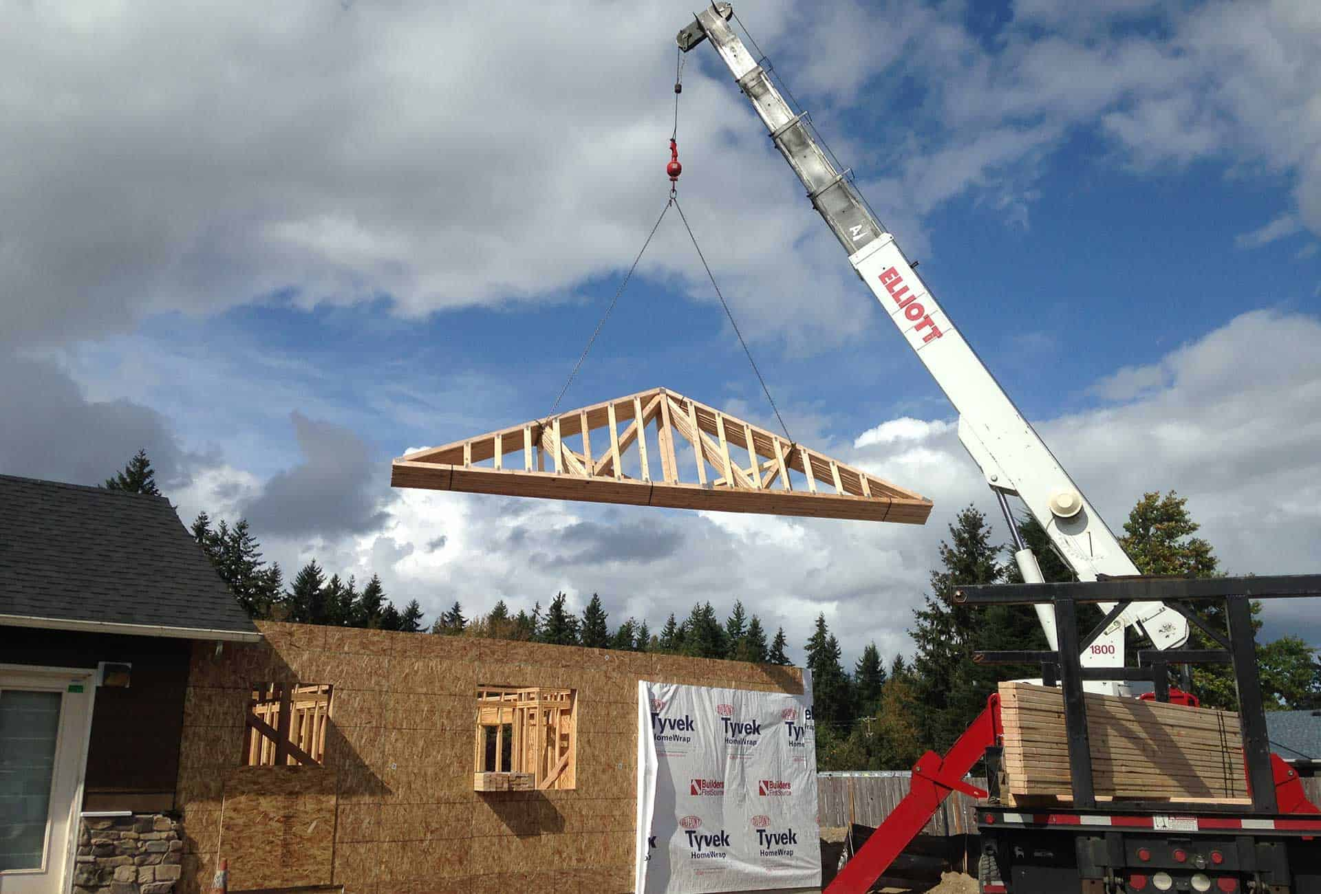 Crane lifting roof during construction of commercial addition for Sentinel Pest Control